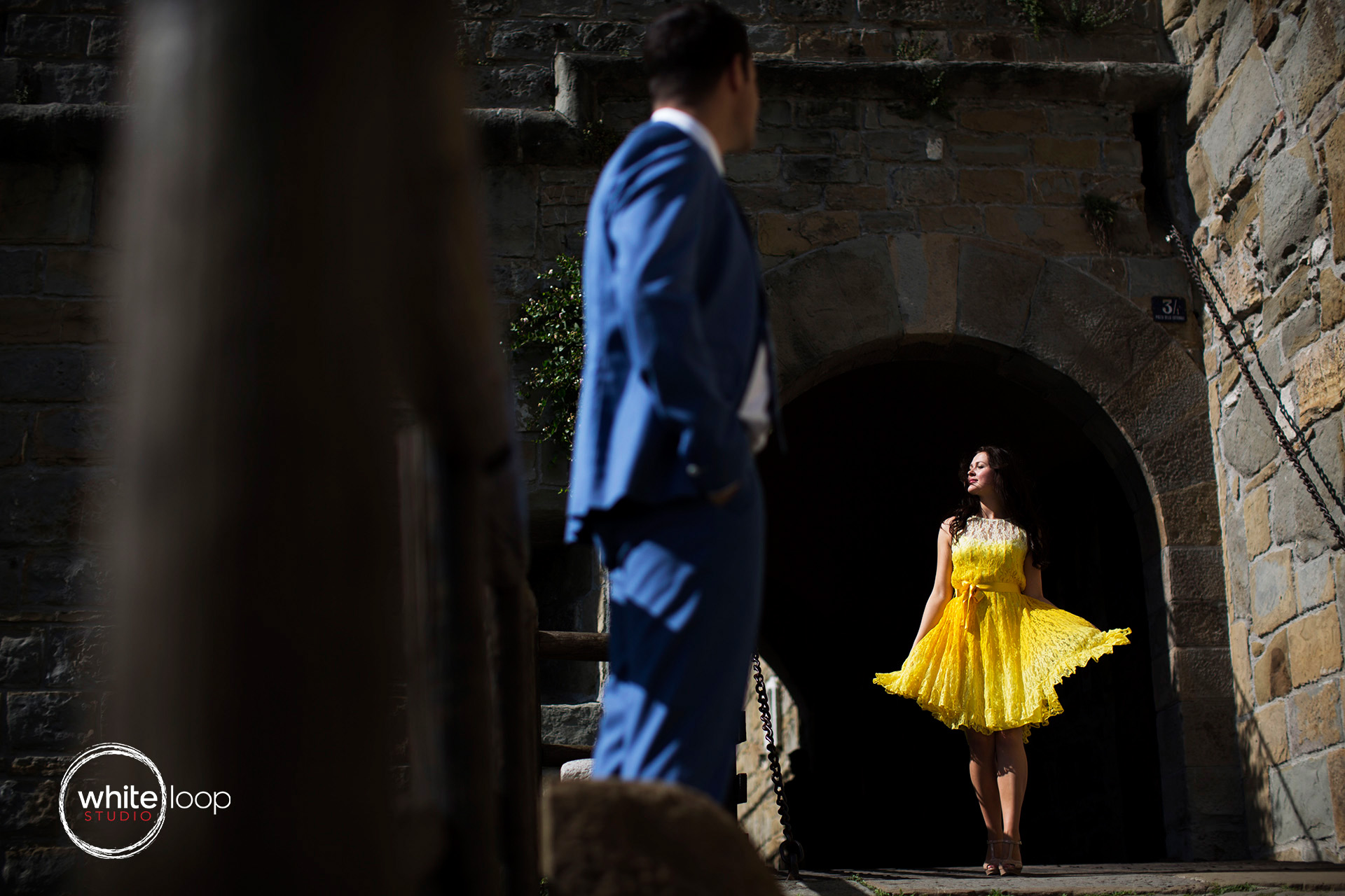 The groom keeping eyes on the bride and her beauty in a yellow dress. A little more formal clothes.