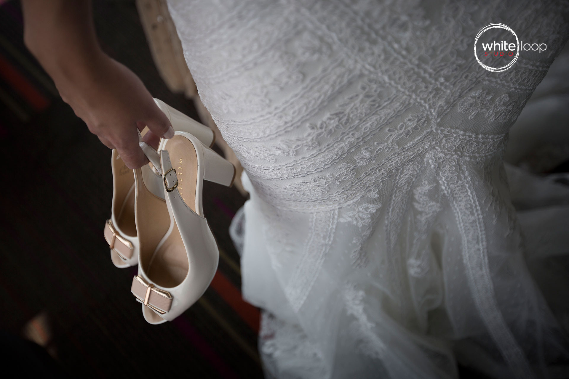 The bride holding her heels.