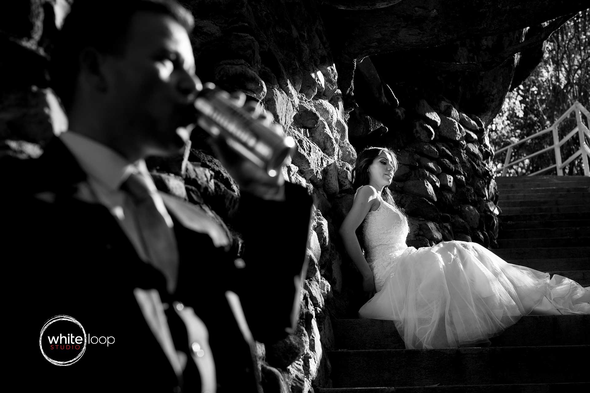 The bride and groom having a good time on the stairs, after the party.