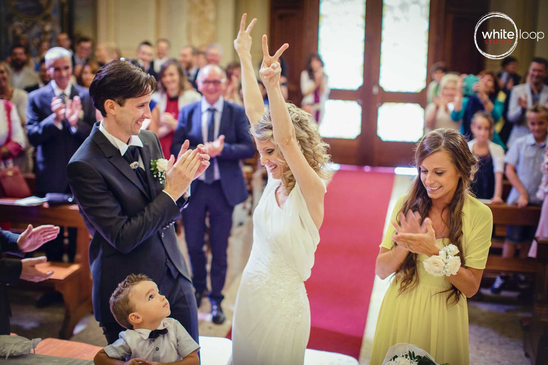 The couple celebrated in the church in religious commitment ceremony, while guests enjoy and applaud the happiness of them.