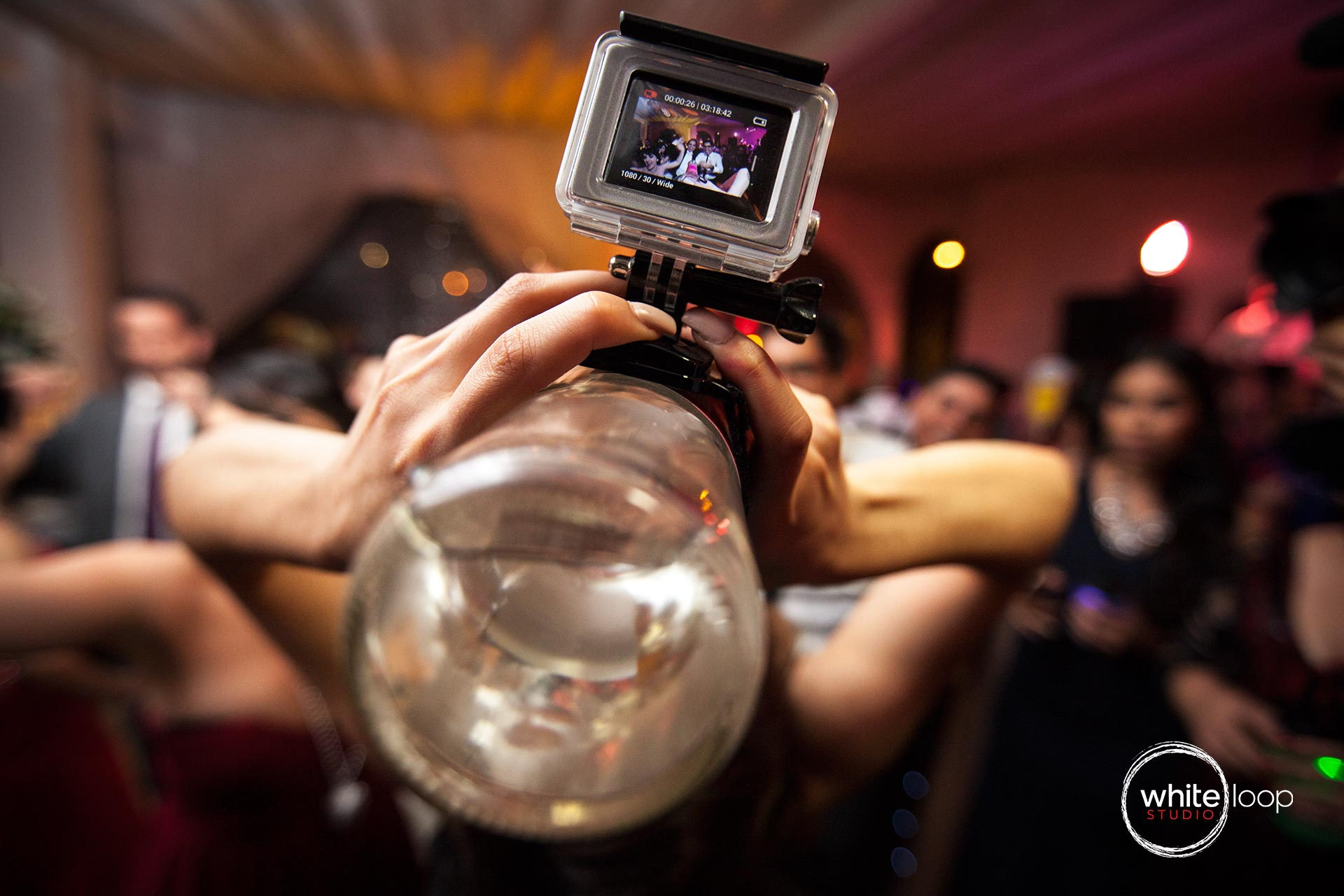 From a Gopro documenting the party, placed in a bottle of liquor.