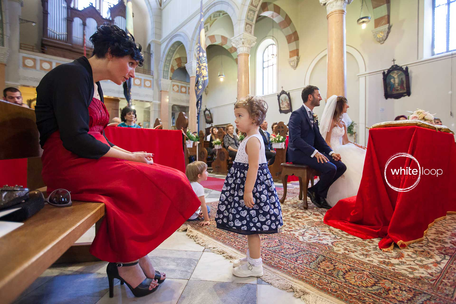 Here is a little girl being blamed by one of the bridesmaids while the ceremony is held