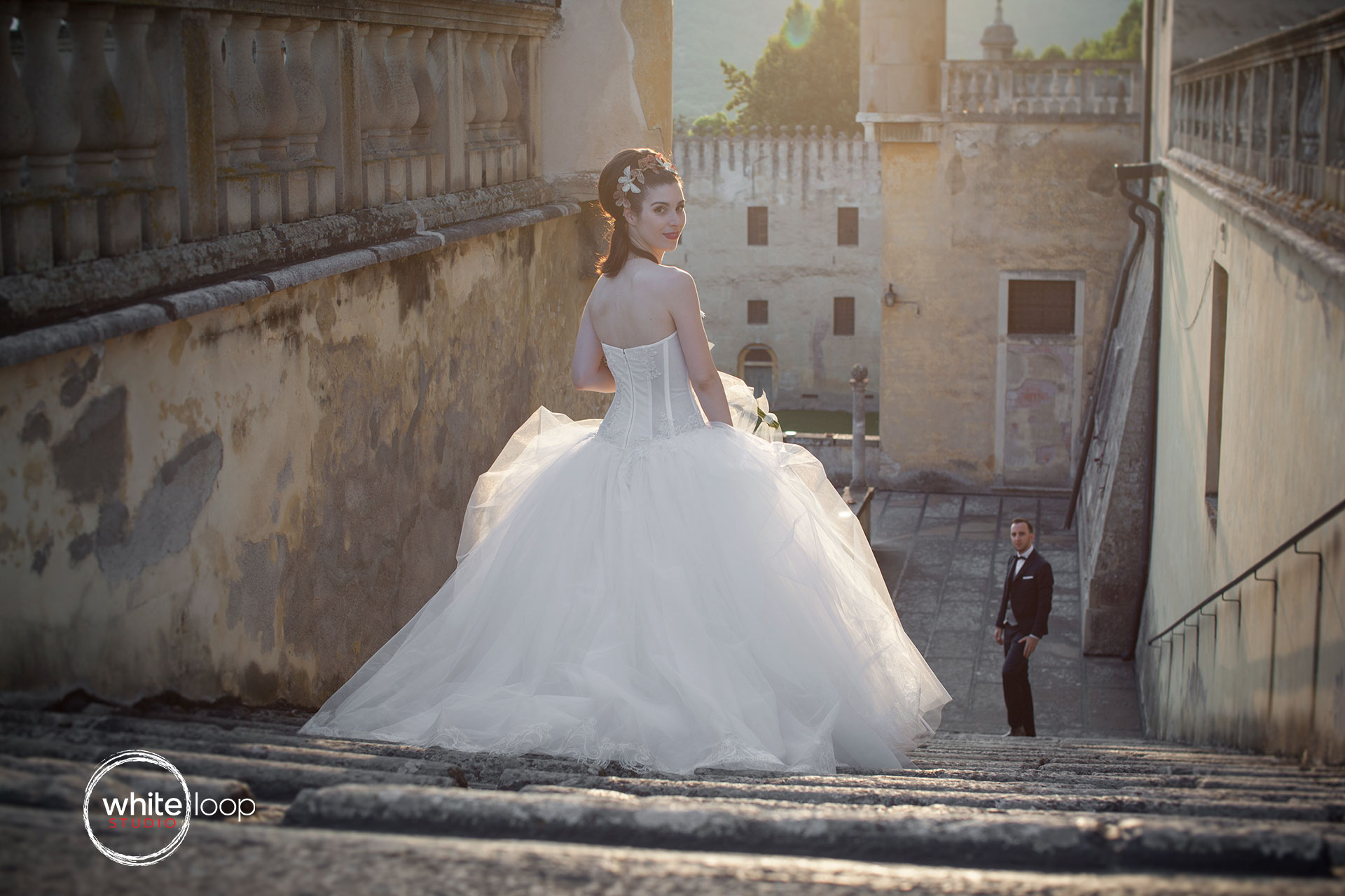 Meanwhile the sunset begins, the groom is waiting for the bride down the beautiful stairway of the Catajo Castle, Padova, the magical place where ancestors still tell us their love stories through the walls.